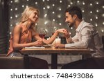 beautiful young couple is... | Shutterstock . vector #748493086