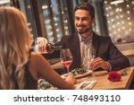 handsome elegant man is looking ... | Shutterstock . vector #748493110