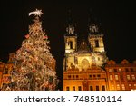 decorated christmas tree stands ... | Shutterstock . vector #748510114
