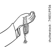 hand drawing muslim hand... | Shutterstock .eps vector #748519936