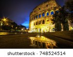 famous colosseum reflecting off ... | Shutterstock . vector #748524514