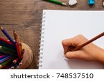 girl hand drawing  blank paper... | Shutterstock . vector #748537510