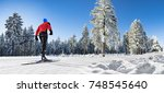 a man cross country skiing on... | Shutterstock . vector #748545640