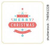 merry christmas vector text...   Shutterstock .eps vector #748561228