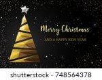 christmas tree golden polygon... | Shutterstock .eps vector #748564378