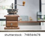 coffee grinder on table  | Shutterstock . vector #748564678