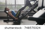 in the gym   muscular man... | Shutterstock . vector #748570324