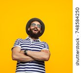 young confident hipster man... | Shutterstock . vector #748584250