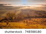 misty morning in autumn central ... | Shutterstock . vector #748588180