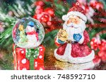 a santa claus and snowman in a... | Shutterstock . vector #748592710
