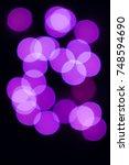 bokeh blurred multicolored... | Shutterstock . vector #748594690