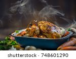 Small photo of Roast whole turkey or chicken in old pan with vegetables.