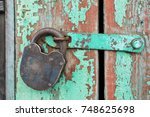 old rusty padlock hanging on an ... | Shutterstock . vector #748625698