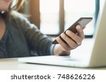 woman use phone on desk in...   Shutterstock . vector #748626226