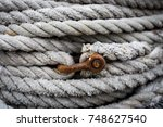 Heap of strong ropes in an fisherman's harbor with a link. - stock photo