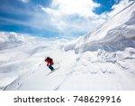 good skiing in the snowy... | Shutterstock . vector #748629916