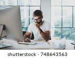 pensive bearded man wearing eye ... | Shutterstock . vector #748643563
