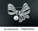 Big Bow With Pearl Brooch...