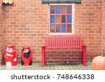 red chairs with brick wall in... | Shutterstock . vector #748646338