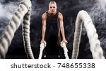 battle ropes session.... | Shutterstock . vector #748655338