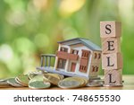 a model house model is placed... | Shutterstock . vector #748655530