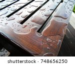 Water Drops On Wooden Surface...