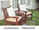 wooden chair standing on the... | Shutterstock . vector #748665304