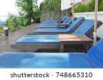 sunbed beside the beach. | Shutterstock . vector #748665310