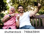 dad and son taking selfie and... | Shutterstock . vector #748665844