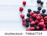 fresh raspberries and... | Shutterstock . vector #748667719