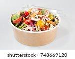 fresh organic mixed green salad ... | Shutterstock . vector #748669120