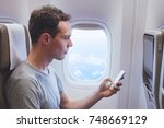 passenger using mobile phone... | Shutterstock . vector #748669129