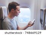 passenger using mobile phone... | Shutterstock . vector #748669129