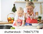 little girl and her blonde mom... | Shutterstock . vector #748671778