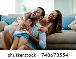 happy familiy spending fun time ... | Shutterstock . vector #748673554