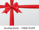 red gift bow and ribbon.   Shutterstock .eps vector #748674109