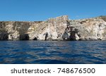 cliffs of the blue grotto ... | Shutterstock . vector #748676500