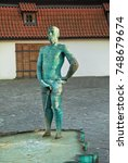 Small photo of PRAGUE, CZECH REPUBLIC - September 07, 2016: : The Piss scultpture by Czech artist David Cerny with two animatronic figures piddling in a puddle in front of Franz Kafka Museum in Prague.