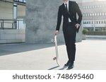 a contemporary businessman... | Shutterstock . vector #748695460