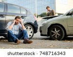 two men calling car help... | Shutterstock . vector #748716343