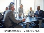 mature manager talking to a... | Shutterstock . vector #748719766