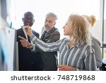 diverse group of focused work... | Shutterstock . vector #748719868