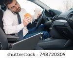man eating an hamburger and... | Shutterstock . vector #748720309