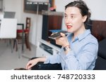 woman talking on the phone with ... | Shutterstock . vector #748720333