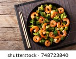 stir frying shrimp with... | Shutterstock . vector #748723840