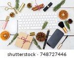 christmas female desktop with... | Shutterstock . vector #748727446