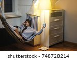 woman is lying in the hammock...   Shutterstock . vector #748728214