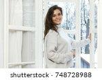 woman is opening window to look ... | Shutterstock . vector #748728988