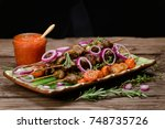 bbq meat on wooden skewers on... | Shutterstock . vector #748735726