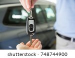 close photo of male car dealer... | Shutterstock . vector #748744900